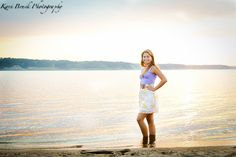 2014 High School Senior girl for posing picture ideas. Senior girl standing in the water by a beach or lake at sunset. High school senior session pose inspiration for senior pictures.