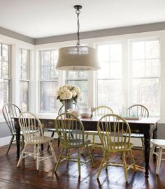 A few $4 cans of spray-paint woke up sedate thrift-store Windsors, each between $15 and $35, in this Oregon home's dining room. The homeowner bought the Pottery Barn burlap lamp on clearance.