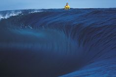 Andy Irons wets his appetite for one of the most intense drops in surfing, peering into the bowl at Gotcha Pro.