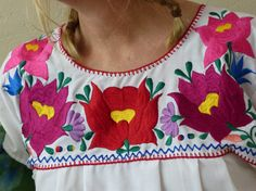 Check out this item in my Etsy shop https://www.etsy.com/listing/238768877/vintage-handmade-embroidered-mexican