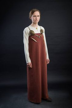 The costume of a rich Birka сitizen 2th half of X century Based on graves bj 856 and 865. Tunik sewn of thin woolen cloth (diamond twill of type W10 according to Inga Hägg), clasped with small round gildet brooch. Apron made of thickest diamond twil cloth dyed with madder and decorated with narrow pattern-woven silk border.