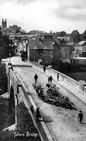.shepherd and sheep crossing Totnes Bridge