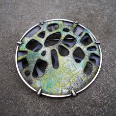 Enamel Brooch by L. Sue Szabo  ||  enamel on copper, sterling silver sgraffito enamel, kiln fired. hand pierced and sawn, hand fabricated, prong set. $650.00  ||  http://www.lsueszabo.com/exhibition_detail.php?pid=100