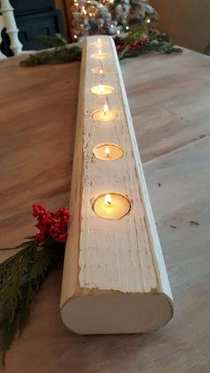 This tea light holder is 32 in length...and has space for 7 tea lights. A perfect low profile centerpiece for your tablescape or coffee table arrangement.
