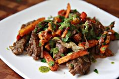 The Noshery | Skirt Steak and Sweet Potato Stir-Fry with Chimichurri Sauce | http://thenoshery.com