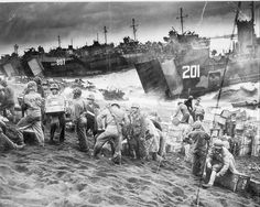Marines unload supplies from USS LSM-201 and USS LST-807, and other amphibious warships beached at Iwo Jima on D-Day, 15 February 1945. US National Archives photo # NWDNS-26-G-4098. The USS LST-807 was Dad's ship.