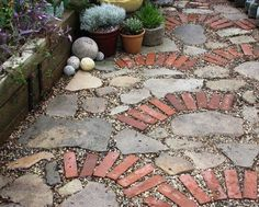 permeable path: broken stone, some bricks, gravel.  I like the mix of the three textures-- maybe we can use as a replacement for grass in front yard where grass refuses to grow (and create a little container garden for some green).