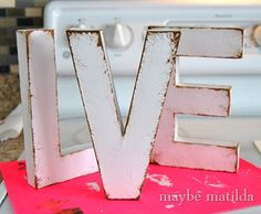 Distressing paper mache letters