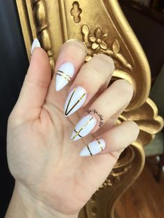 White almond nails with gold striping tape