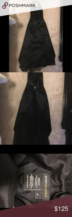 Gorgeous Black Satin Evening Gown by BCBG Size 4 Racer back neck line with cinched waist. Beautiful crystal brooch and small of back with a tulle train. When on the skirt shapes to a column style dress with tulle train in the back. Small stiletto size hole in tulle (can easily be trimmed by your tailor if you want) My all time favorite dress from BCBG my rib cage no longer fits in it sadly :( BCBG Dresses Backless