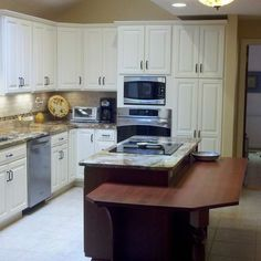 Example of a *lowered* eating area attached to an island.  Hmmm -- seems more contemporary in style to me than the *raised* eating counter?  Why????  Bridgeport Eclectic Kitchen Photos Design, Pictures, Remodel, Decor and Ideas - page 3