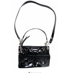 """Coach black glossy hippie purse 12"""" x 8"""" x 2"""". Cross body strap can be removed and can be worn over the shoulder. Two outer pockets. Main pouch is closer by a zipper. Inside, one zip pouch and 2 phone sized pockets. The lining is hot pink and has a few unnoticeable marks from pens/makeup. The outside is a black shiny patent leather wth a quilted pattern. In great condition  no sign on wear on purse and look very new although it has been worn for about one month Coach Bags"""