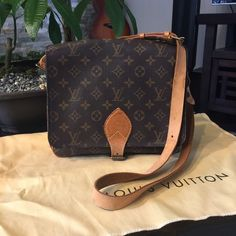 Authentic LV cartouchiere GM Authentic date code 8906SL , the bag is in great condition and clean inside and out! Some scratches on the leather (see pics) which is normal due to use...but all in all in good condition... Size L 10' H 8.2 / Does not come with dustbag and box. Please see picture details and ask questions before purchasing to avoid unnecessary returns!! Louis Vuitton Bags Crossbody Bags
