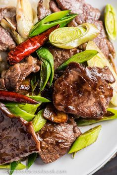 Classic & easy to make - and REAL Chinese!   Scallion Beef Stir Fry (葱爆牛肉) - The beef is tender, moist, and caramelized as it cooks in a sweet savory sauce. It takes only 15 minutes to prep and cook!   omnivorescookbook.com