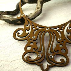 Laser cut leather necklace.