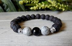 Lava Rock mens strength bracelet is made with a Volcano Rock, Black Onyx and Zebra Jasper. Earthy and strong. Gemstone beaded bracelets for men.