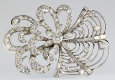 "Lot 966, A platinum diamond spray brooch, 18 grams, 2"" x 1 3/4"", est  £3250-3750"