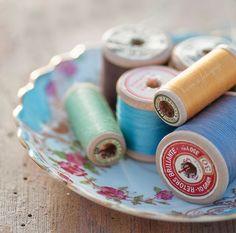 Vintage thread on wooden spools.