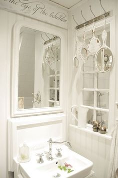 .love this bathroom ... notice the window divides sink from shower
