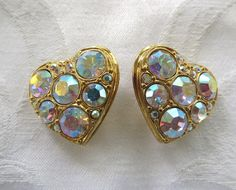 Kirks Folly Heart Earrings, Vintage Rhinestone Heart Clip Earrings, Kirks Folly Jewelry  Vintage Kirks Folly heart clip earrings with rainbow aurora borealis rhinestones.  ... #vintagevoguetreasure