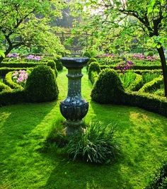A resting bench in the distance is perfect for admiring the sundial at Carney House Gardens in Gloucestershire, England.