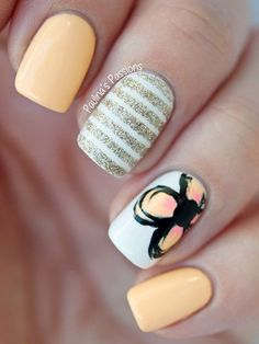 Pretty light pastel colors rock this nail art design! Bisque shades play along with white shades in this artistic looking design. Striped glitter is also added as well as a cartoon drawing of an orange hibiscus over a plain white matte. Pleasing to the eyes and sweet looking nail art fashion.
