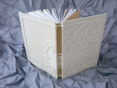 Book binding with needlework on Behance