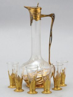 an art nouveau orivit gilt Liquor set including decanter and shot glasses