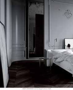 PARIS APARTMENT interior design by Jessica Vedel.  Absolutely love this bed set up with the plaster detailing on the wall behind.