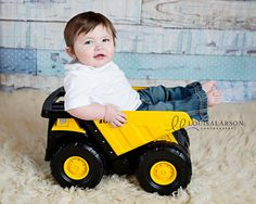 Baby boy photography Vermont.  Louisa Larson Photography.  8 month old boy.  He's a boys boy so you have to put him in a truck, right?  They fit just perfectly - it's one of my favorite props.  When he comes back to the studio for his one year birthday, I'll have him pushing it around.