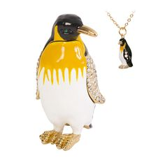 This fun marching penguin trinket box is encrusted with multiple Swarovski crystals on its wings. The penguin is a pretty way to keep your small jewelry safe and organized, and the included matching pendant is a stylish accessory.