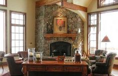 Corner stone fireplace country style living room with high ceiling