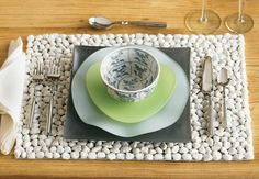White River Stone Placemats: Smooth white stones add an entirely new, marvelously functional and bold dimension to traditional dining table decor. The white surface provides a flattering, coolly elegant backdrop for your table.