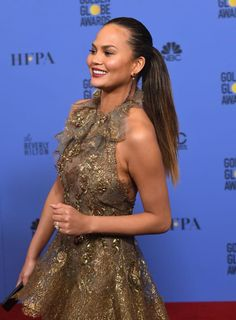 Chrissy Teigen Photos - Model Chrissy Teigen walks into the press room during the Annual Golden Globe Awards at The Beverly Hilton Hotel on January 2017 in Beverly Hills, California. Chrissy Teigen Photos, Spike Tv, Lily Aldridge, Ellie Goulding, Golden Globe Award, Body Modifications, Plastic Surgery, Formal Dresses, Womens Fashion