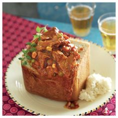 Lamb bunny chow - Mary Di - Lamb bunny chow A well-known and loved South African dish, the bunny chow is a cousin of the kota. South African Dishes, South African Recipes, Indian Food Recipes, Sugar Free Breakfast, Octopus Recipes, Heritage Recipe, Lamb Recipes, Cooking Recipes, Beef Dishes