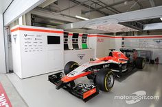 The Marussia Team of Jules Bianchi, sits prepared, but not racing, in the pit garage Marussia F1, Russian Grand Prix, Japanese Grand Prix, Watch F1, End Of The Line, Mclaren F1, Race Day, One Team, Formula One