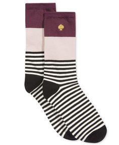 Bright and cheery blocks of color top a pair of playfully striped crew socks from kate spade new york. | Cotton/polyester/spandex | Machine washable | Imported | Colorblock striped design | One size f