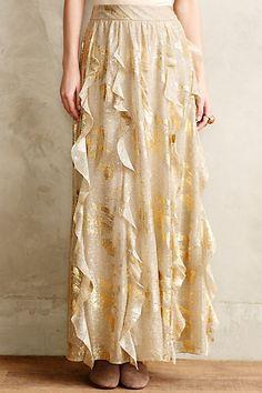 Long ivory and shimmering gold full skirt with corkscrew fluttering ruffles. Fallen Star Maxi Skirt by Moulinette Soeurs from Anthropologie.