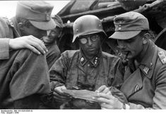 "An Untersturmführer of 3. SS-Panzer-Division ""Totenkopf"" and an Oberleutnant des 228. Infanterie-Regiments during a briefing. Romania, 1944."