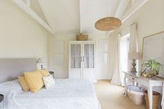 Natural textures and pops of yellow give this neutral bedroom lots of character.