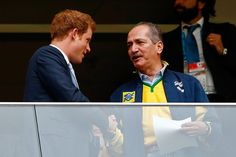 Prince Harry (L) speaks to Brazil Minister of Sport Aldo Rebelo during the 2014 FIFA World Cup Brazil Group A match between Cameroon and Brazil at Estadio Nacional on June 23, 2014