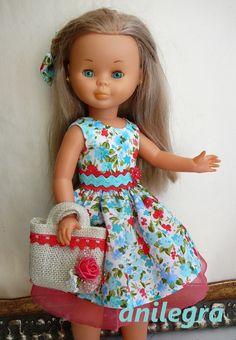 Vestido Turquesa y coral con cestito y pinza para el pelo  22 euros