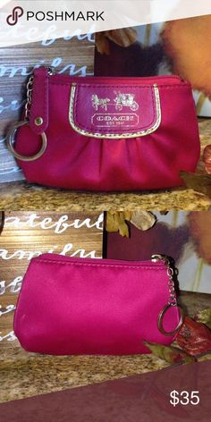 Authentic Coach Amanda Satin Red Coin Pouch 🎄🎄 Don't forget to bundle and save 💝💝💝Perfect Christmas accessory. Authentic Coach Amanda Red Satin Super Classy Horse & Carriage Coin Pouch.  Brass hardware. Zip closure. Interior is lined in a beautiful orange satin fabric and is in perfect condition. Pet-free as well as smoke-free home. Coach Bags Clutches & Wristlets