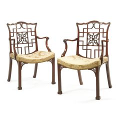 A Pair of George III mahogany 'Chinese' armchairs in the manner of Robert Manwaring, circa 1770.