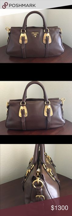 Prada Bauletto Calf Leather Handbag Prada Bauletto Calf Leather Handbag in the color Bruciato (Chocolate) with Gold metal hardware. NEW NEVER WORN. I prefer to carry my Prada shoulder Handbag. This handbag comes with its Prada Card of authenticity, 1 Prada dust bag and a detachable shoulder strap. The interior of this handbag is lined in the Prada logo with a zip interior pocket and has a top zip closure.  Retails at $2,800. SERIOUS inquiries only. BEFORE making an offer- DO your research…