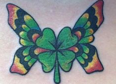 4+Leaf+Clovers+with+Flowers | Four Leaf Clover Tattoo Ideas : Beautiful Butterfly Four Leaf Clover ...