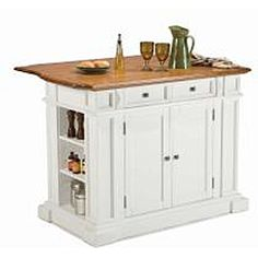 @Overstock.com - The kitchen island is constructed of solid hardwoods and engineered wood with a White finish and a distressed Oak top. Features include an antique nickel hardware, storage drawer, adjustable shelves, and storage on ends with an adjustable shelf.http://www.overstock.com/Home-Garden/Home-Styles-White-Distressed-Oak-Kitchen-Island/6624507/product.html?CID=214117 $707.39