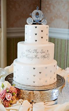 Wedding cake made for a princess complete with Cinderella's Coach cake topper