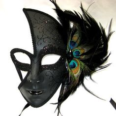 Female Venetian Mask with black Sparkles and Peacock Feathers RedSkyTrader, http://www.amazon.com/dp/B00435XCVM/ref=cm_sw_r_pi_dp_38eNpb1D2FX0A