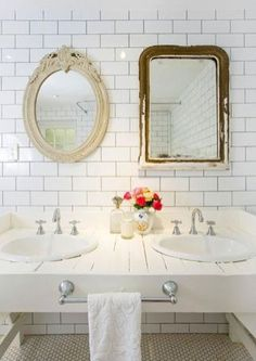 double sink with two different vintage mirrors